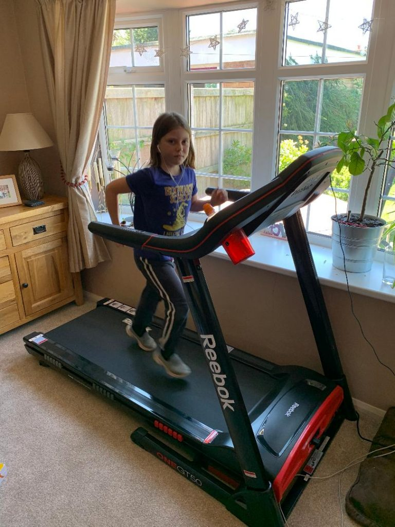 Imogen running on her treadmill at home