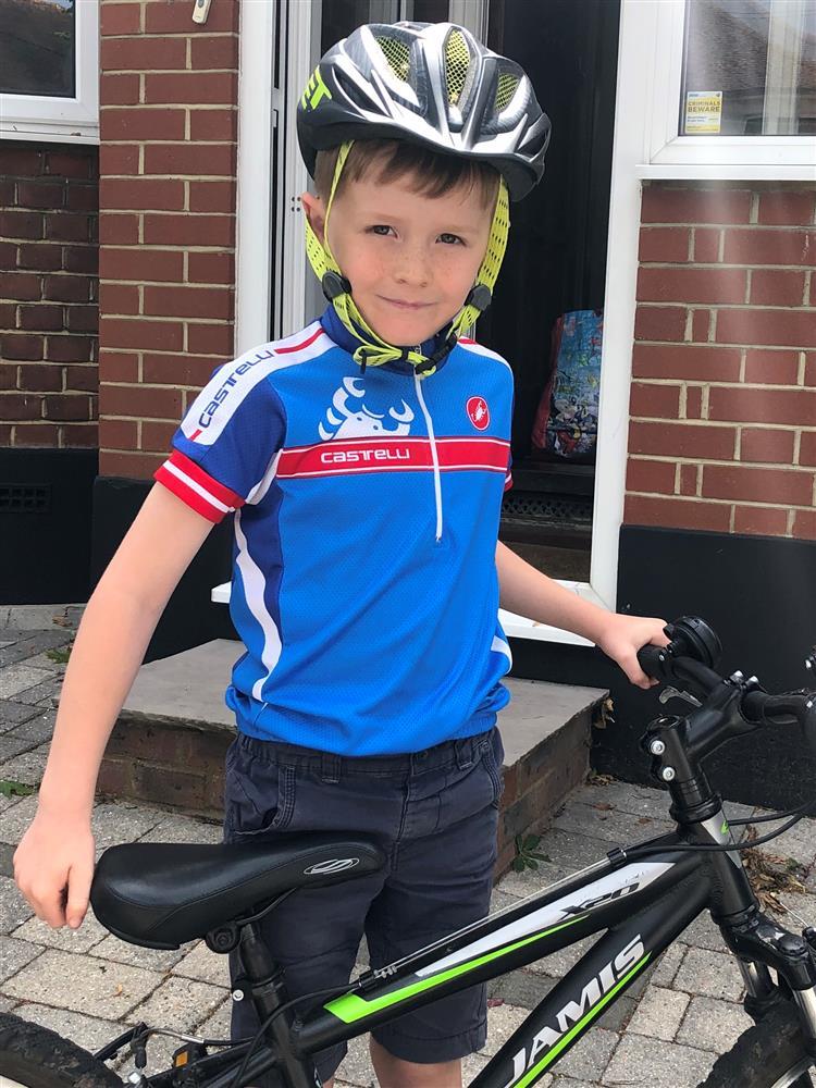 Dan standing with his bike